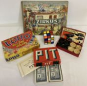 """A small collection of vintage games and a German """"Zirkus"""" children's book."""