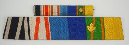 Baden: Lot von 2 Feldschnallen eines Offiziers.Je mit 6 bzw. 7 Auszeichnungen, mit Auflage des