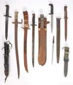 Second World War British army machete in scabbard, together with a diving knife and other bayonets