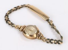 Accurist 9 carat gold ladies wristwatch, the signed silver dial with baton markers, manual wound, on