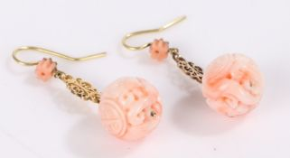 Pair of Oriental carved jade earrings, each earring with a carved ball above a scrolled pierced