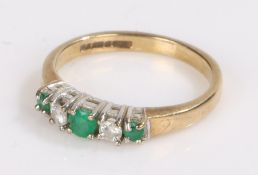 9 carat gold ring set with three emeralds and two pieces of clear paste, ring size J1/2, 1.9g