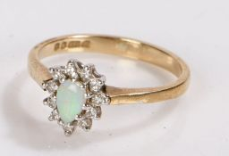 9 carat gold ring set with an oval opal surrounded by diamond chips, ring size L, 1.9g
