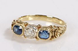 Sapphire and diamond ring, the central diamond flanked by two sapphires, sapphire estimated at 0.