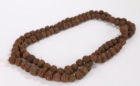 String of prayer beads formed from dried seeds/nuts, 170cm long