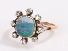Opal and diamond ring, the central 1.5ct opal surrounded by eight diamonds estimated diamond