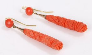 Pair of carved coral earrings, the drops with geometric decoration and gilt mounts, 10.3g