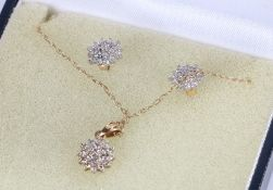 9 carat gold and diamond chip set jewellery set, comprising pair of earrings, necklace and