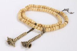 String of bone prayer beads, 80cm long