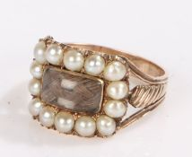 19th Century mourning ring, the central rectangular woven hair panel surrounded by a border of