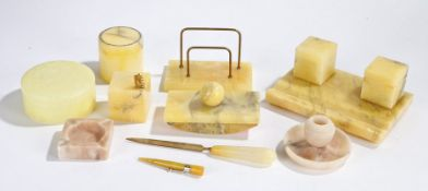 1920's onyx desk set, to include a letter rack, inkwells on stand, paperweight and blotter,