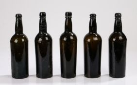 Five 19th Century brown glass bottles, with ring tops above the cylinder bodies, 30cm high, (5)