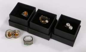 Cubic zirconia set crossover style ring, tigers eye ring and pair of earrings, citrine style ring,