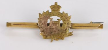 9 carat gold brooch, with central crest of the Suffolk regiment, gross weight 2.2g