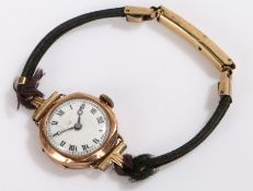Ladies 9 carat gold wristwatch, the white dial with Roman numerals and faint retailers name,
