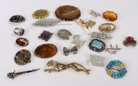 Brooches, to include silver and enamelled, banded agate, clear paste and mother of pearl examples (