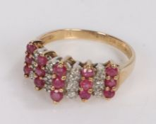 9 carat gold ring set with diamonds and garnets, ring size K. 2.1g