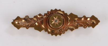 15 carat gold brooch, with central diamond chip surrounded by foliate decoration, 2.9g