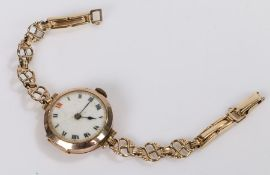 9 carat gold ladies wristwatch, the white dial with Roman numerals, manual wound, on a rolled gold