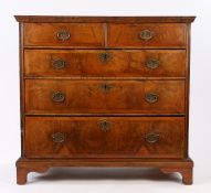 George II walnut chest of drawers, the rectangular top above two short and three long graduated