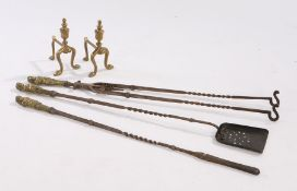 Set of late 19th Century brass and steel fire irons, with figural brass busts above the steel
