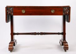 William IV rosewood sofa table, the rectangular top with drop end flaps above a frieze drawer and