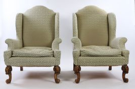 Howard & Sons, an impressive pair of armchairs, the high arched back above a deep seat and swept