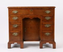 George III mahogany and feather banded kneehole desk, the rectangular top above seven drawers