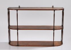 An elegant George III set of mahogany hanging shelves, with three rectangular shelves with rounded