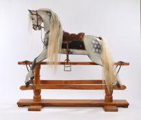 Fine F.H. Ayres rocking horse, circa 1915, large size, dapple grey with leather saddle, horse hair