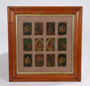 Collection of twelve Persian Qajar lacquer playing cards, with figures and animals, mounted in a