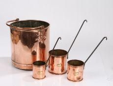 Graduated set of three 19th Century copper grain measures, with brass plaques engraved grain and