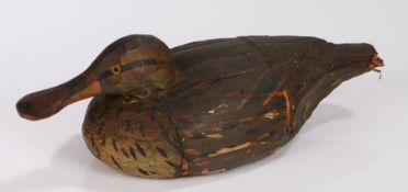 Early 20th Century Folk Art straw decoy duck, with orange eyes and black streaks to the deep brown