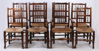 Matching set of eight oak and ash Lancashire dining chairs, each with shaped rails and rows of