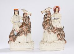 Pair of 19th Century Staffordshire flatback pottery figures, of a lady and gentleman riding goats,
