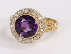 Amethyst and diamond set ring, the central amethyst at 2.73 carats and a diamond surround, ring size