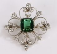 Tourmaline and diamond set brooch, the central 4.10 carat tourmaline with a diamond surround on