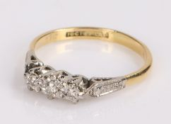 18 carat gold diamond set ring, with three diamonds to the head, ring size N