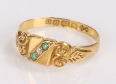 18 carat gold emerald and diamond set ring, with one diamond flanked by two emeralds, ring size M