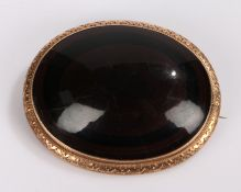 9 carat gold mounted agate brooch, the oval agate within a 9 carat gold mount, 50mm diameter