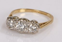 18 carat gold diamond set ring, with three round cut diamonds to the head, ring size P