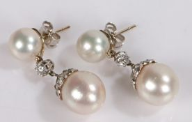 Pair of pearl and diamond set earrings, the drops with two pearls set with diamonds to the link