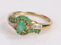 9 carat gold emerald and diamond set ring, with a central emerald flanked by further emeralds and