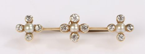 Diamond and pearl brooch, with three cross sections set with a central pearl and diamond surround to