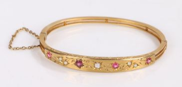 Victorian ruby pearl and sapphire set bangle, the gemstones set to a foliate design, 62mm diameter