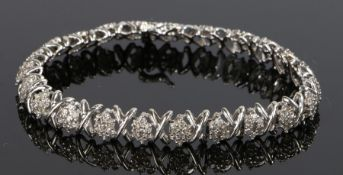 10 carat white gold diamond set bracelet, with X links between diamond clusters, 13.4 grams, 19cm