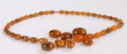 Amber bead necklace, the graduated reconstituted amber in butterscotch and orange with a clasp