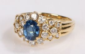 18 carat gold sapphire and diamond set ring, the central oval sapphire and a round cut diamond