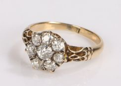 18 carat gold and diamond ring, the central diamond surrounded by a further seven diamonds in a