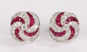Pair of 18 carat white gold ruby and diamond set earrings, the studs set with a curved ruby and